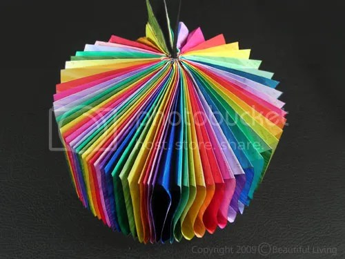 This colorful pinwheel was created using an old Moleskine planner, markers and a little bit of glue.