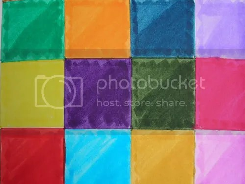The darker triangles of color in each color blocks were created using multiple layers of color.