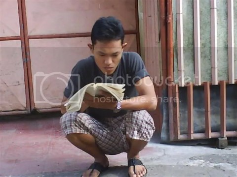 Darsana learn something in front of the boardinghouse