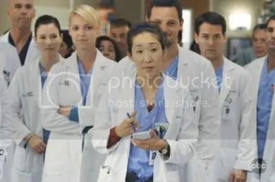 Christina and other Grey's Anatomy folks in their scrubs