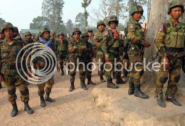 A Cambodian soldier carries a machine gun