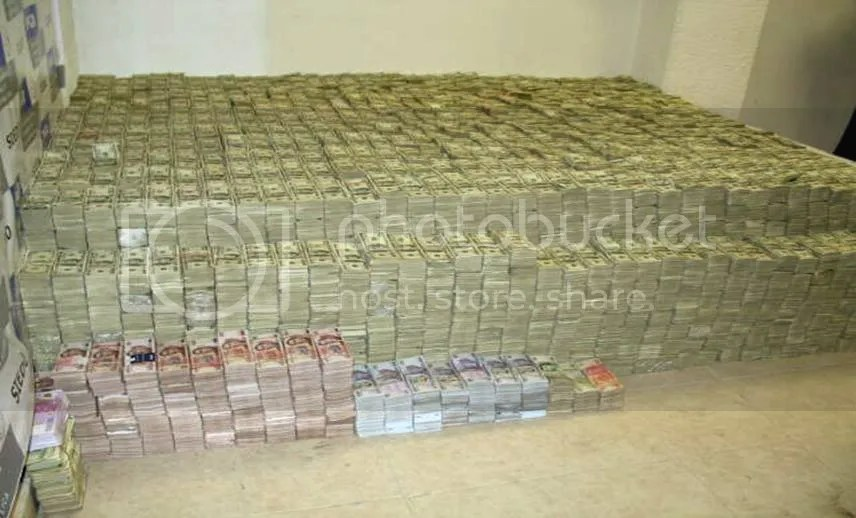 pile of money photo: MUCH MONEY pile-of-money-1.jpg
