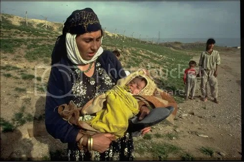 Kurdish refugee mother and child in a march to the refugee camps in Southeast Turkey
