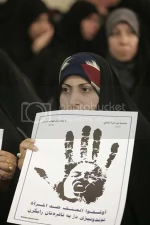 A poster at a Najaf rally reads Stop violence against women. Image: Alaa al-Marjani / AP