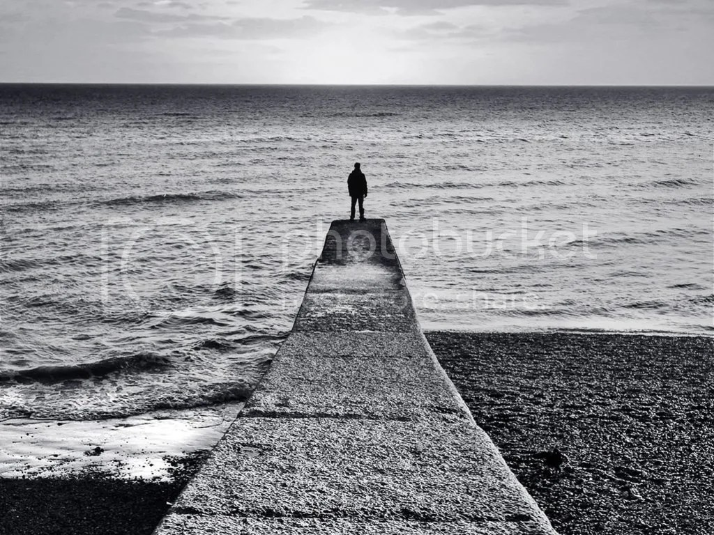 lonely man at beach