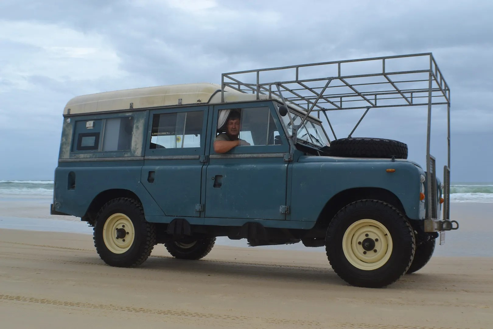 Land Rover Defender with pop up roof and over hood rack
