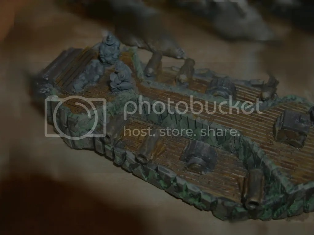 The Orc Raider Heavy Cruiser, with the rock lobbing trolls on deck, needing another going over with some grime.