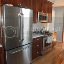 Red Cherry Cabinets Kitchen Modern Appliances Kitchens With Light Countertops