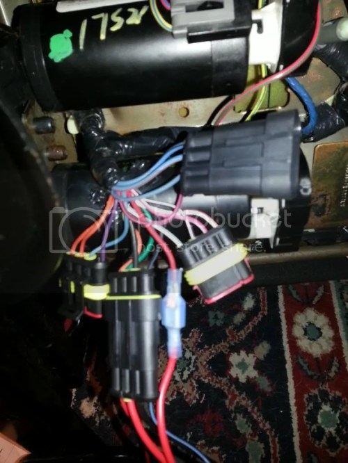 small resolution of this is a pic of the dg and bk wires that i am using as my power source for both seats you can see the connector i cut off in the back ground