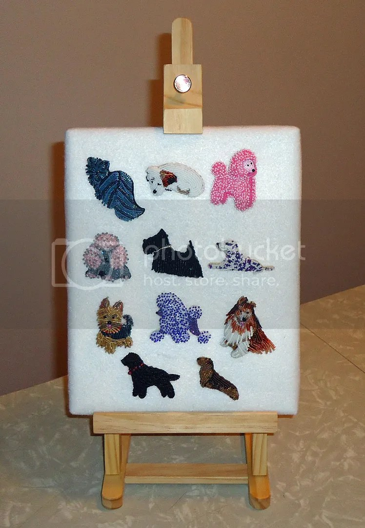 pin pendant brooch display felt-covered canvas on table top easel