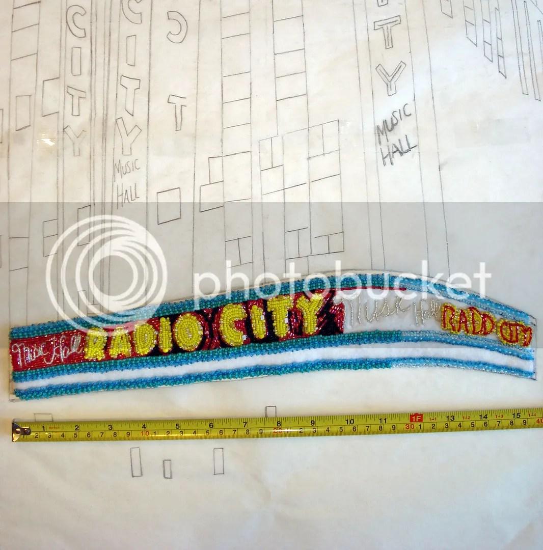 beaded Radio City Music Hall painting mixed media bead embroidery beadwork NYC taxi cab scene