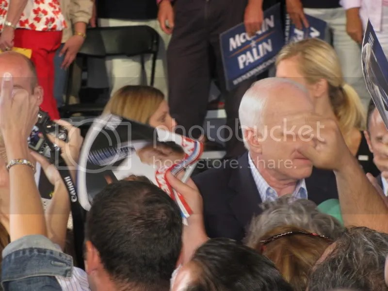 Probably my favorite picture of the whole rally - I took this right as somebody reached out to shake McCains hand, but it looks like theyre grabbing his face