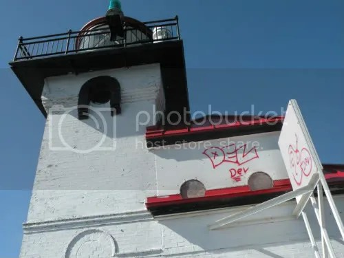 tagging matching the inactive lighthouse's paint scheme