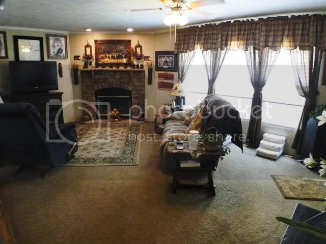 Woodburning rocked fireplace in the family room... there is also a separate formal living room, Franklin NC Manufactured, Franklin NC Mobile Homes