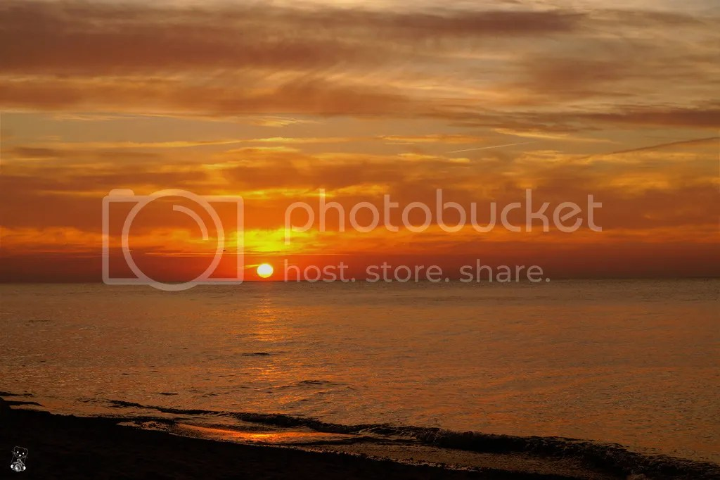 Setting sun seen from the beach at Backenberg of Wittow Peninsula, on the Rügen Island, at the Baltic Sea in Germany