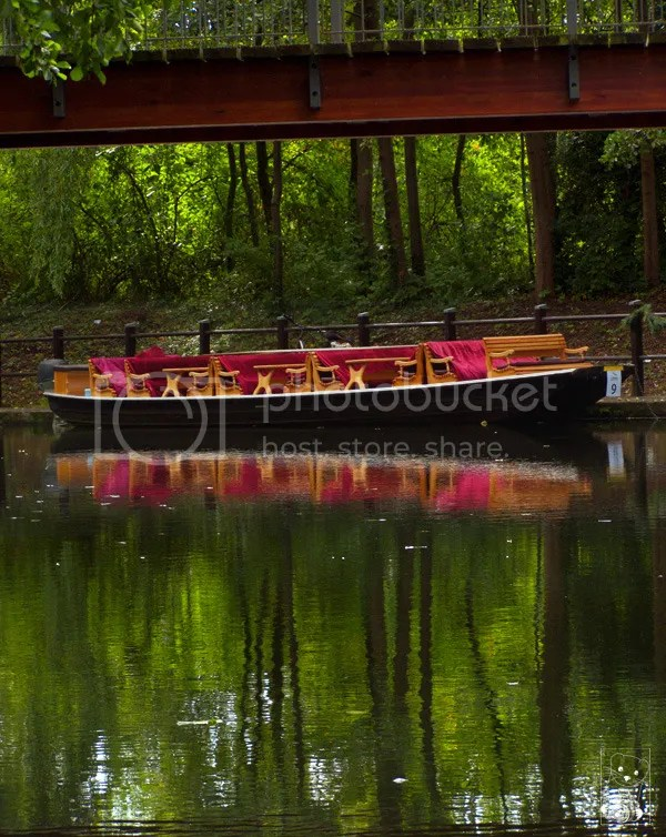 Empty boat, decorated in red, is awaiting for guests on the river Spree in Spreewald in Germany