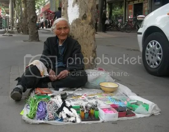 Grandma peddler, miao Guiyig, henan, china - 2