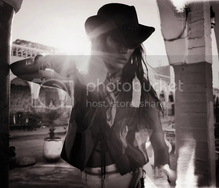 hat,feather,afternoon light,black & white,vest,native america