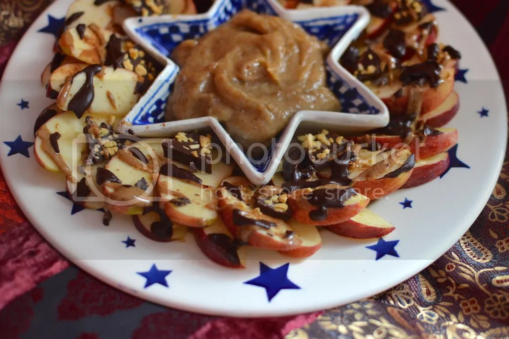 Apples sprinkled with cinnamon, drizzled with almond butter, raw chocolate sauce with a 'Moo Free Bunnycomb Bar', served with a Raw Vanilla Fudge Caramel Date sauce