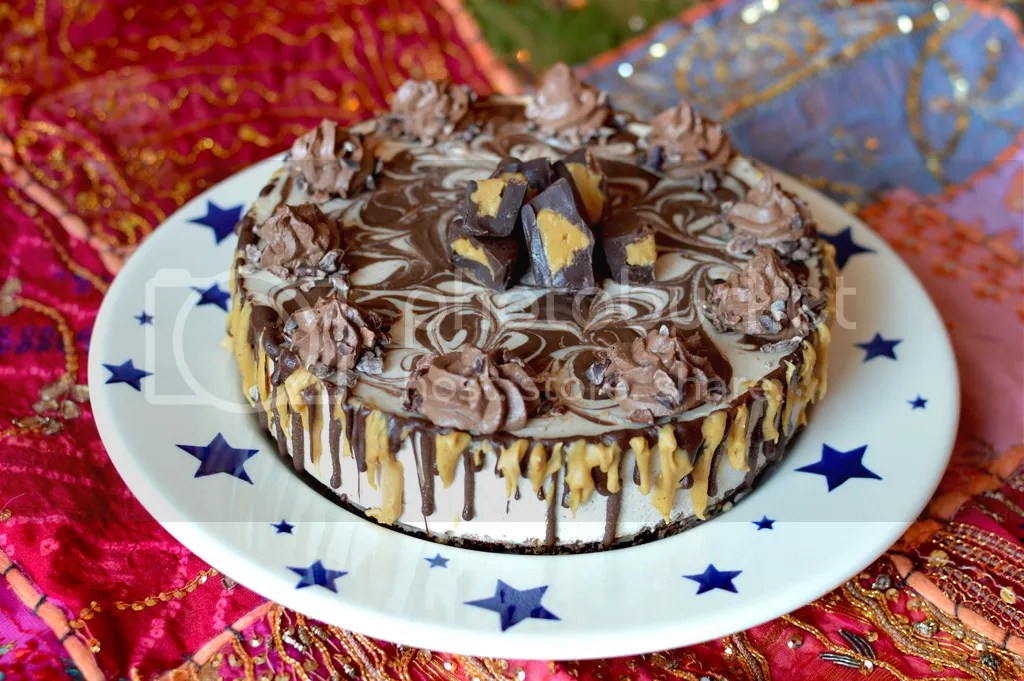 Raw peanut butter cheesecake, swirled with chocolate ganache, and topped with raw chocolate 'buttercream' icing.