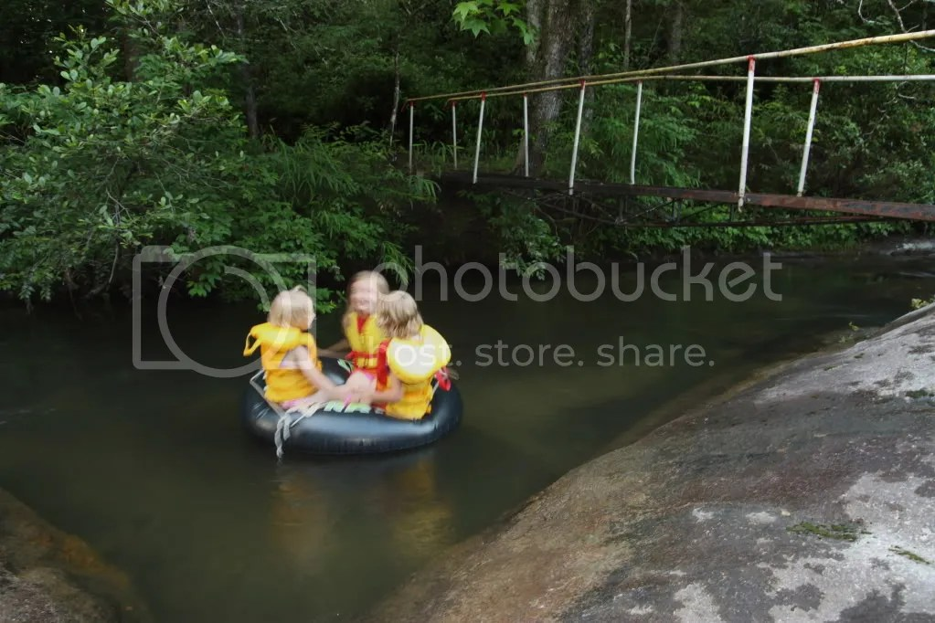 three girls tubing on the river at Palmetto Cove
