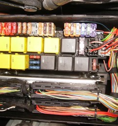 i also looked in the trunk alongside the cd changer and there are no access panels for a fuse block i think there s something by the battery but that s on  [ 1024 x 768 Pixel ]