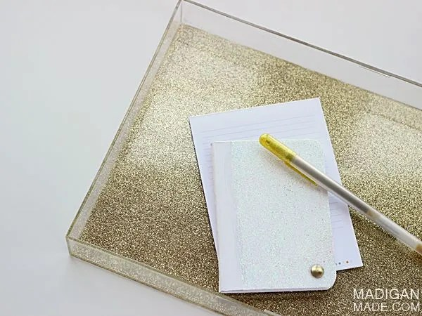 Coat the bottom of a clear frame to make a glitter tray