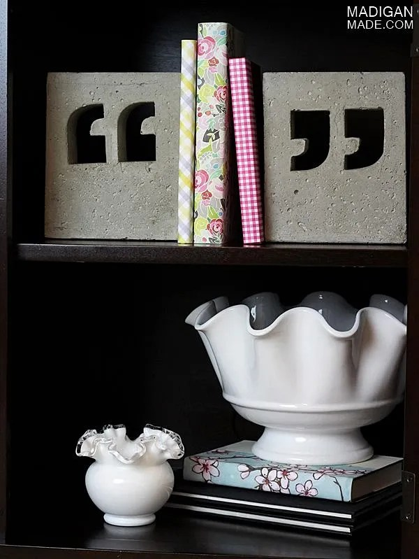 Bookshelf decorated with DIY concrete bookends and vintage paper covered books