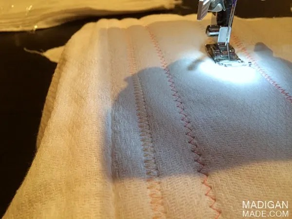 Add stitched lines to the diapers for textured burp cloths.