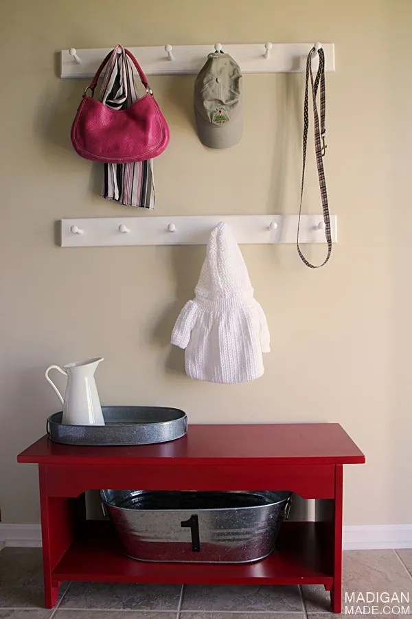 Simple (and stylish) updates for a functional foyer (love the shaker peg hooks!)