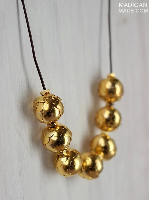 Simple necklace made from gold thumtacks and brass hardware - gorgeous!