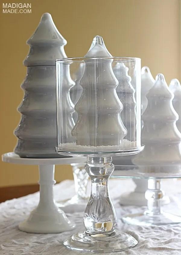 Milk glass trees in hurricane vases... look like big snow globes!