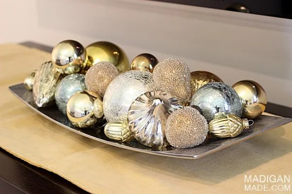 Gold and silver vintage style ornaments in a tray