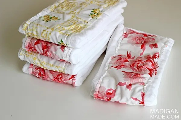 Sew vintage fabric to cloth diapers for fun, colorful baby burp cloths.