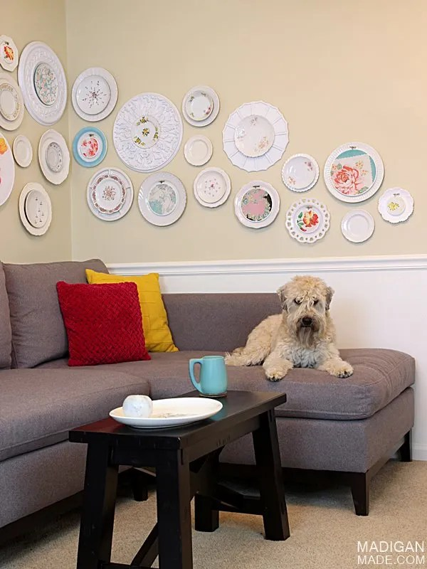 DIY wall art made with vintage plates, fabric, hoops and ceiling medallions