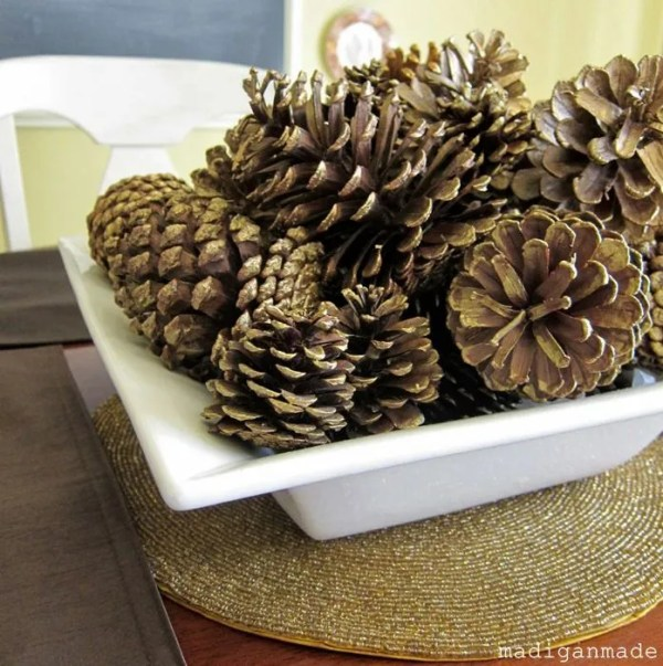 golden pinecones in a large bowl