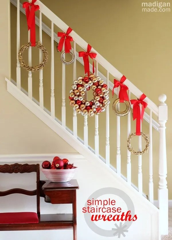 Simple idea: Hang wreaths down the stairs - part of the holiday home tour at madiganmade.com