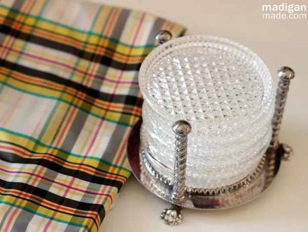 thrift store glass coasters and plaid fabric