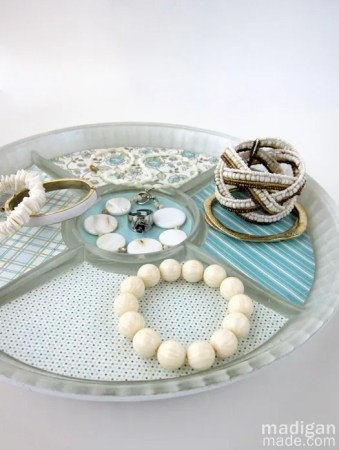 Mod Podge a tray for jewelry storage