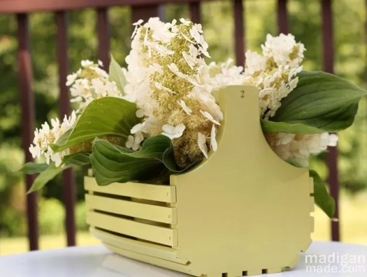white simple hydrangea bouquet in basket