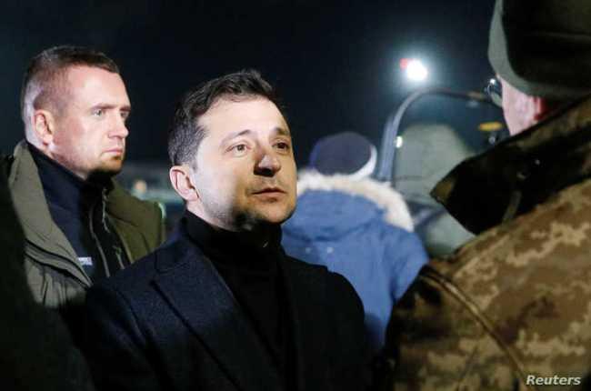 Ukraine's President Volodymyr Zelenskiy attends a ceremony to welcome Ukrainian citizens exchanged in a prisoner swap, at Boryspil International Airport, outside Kyiv, Ukraine, Dec. 29, 2019.