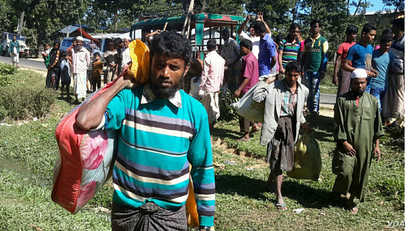 Some Rohingya men have just arrived from Myanmar, at an unidentified place in Cox's Bazar district, Bangladesh. More than 50,000 Rohingyas have crossed over to Bangladesh in the past 11 weeks, since violence broke out there.