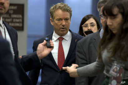Sen. Rand Paul, R-Ky., talks to reporters before attending the impeachment trial of President Donald Trump on charges of abuse…