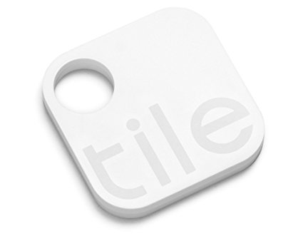 Picture of Tile device. Device is a white square with rounded corners with the word Tile in a light grey. It also has a round hole in a corner for a key ring.