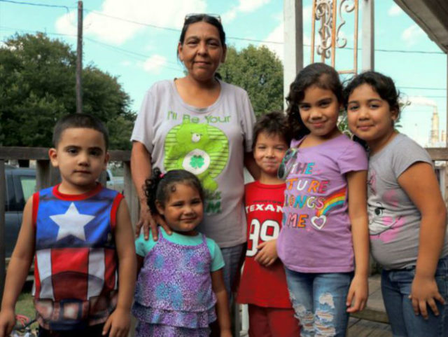 """Paula and her family on the porch across from the Valero """"toxic waste"""" refinery."""
