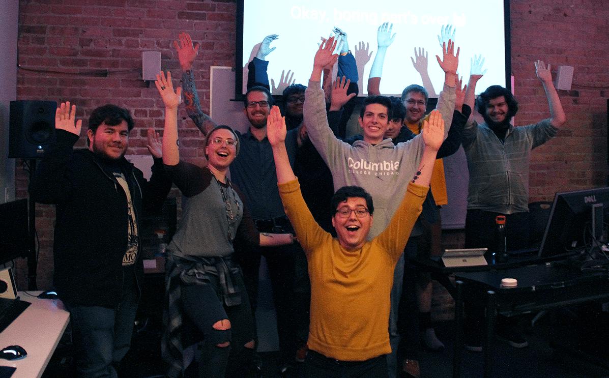 Photograph of students and IAM Alumni Jeremy Kahn at HackerJacks event