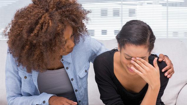 comforting crying woman
