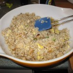rice and chicken in orange bowl