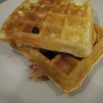 close up of waffles in white plate