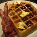 waffles and bacon on white plate